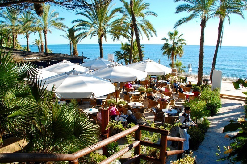 Cappucino grand cafe in Marbella with sea view by Costas & Casas